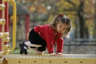 hanna-playing-on-the-playground-in-eisonhower-park
