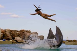 sarah-riding-dolphins-in-dolphin-cove-jamaica